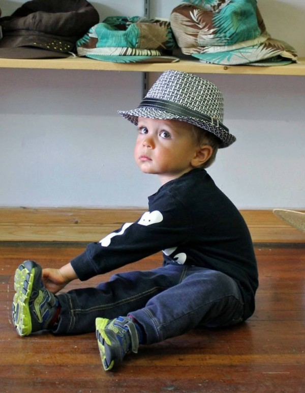 child wearing a fedora